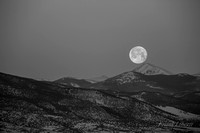 Moonset over Colorado mountains in Alamosa CO